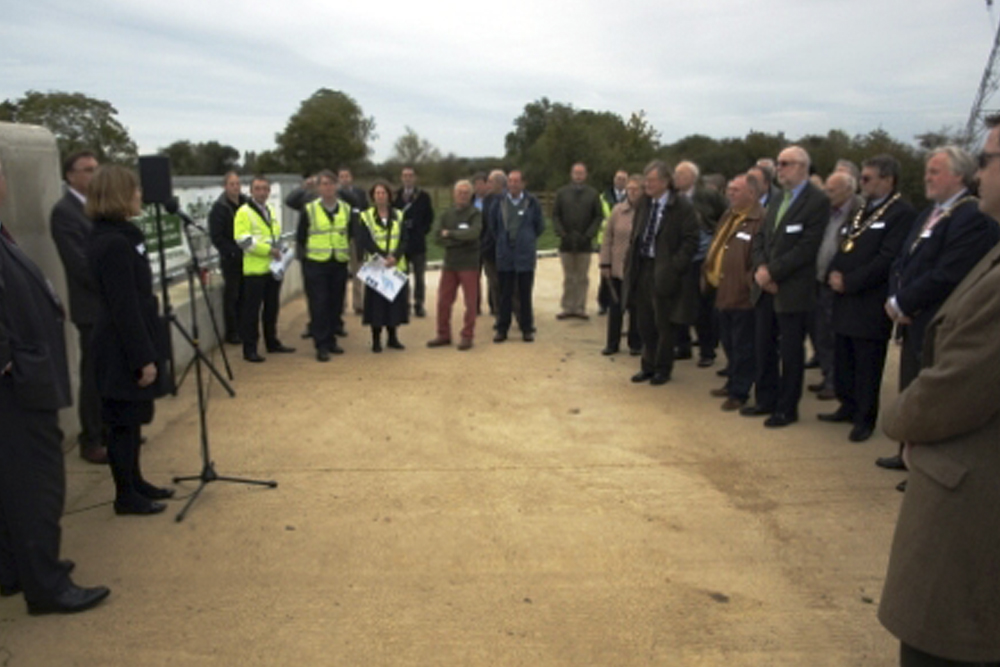 The project team and sponsors gather at one of the scheme's two large control structures.